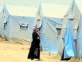 Mülteci kadınlar elbiseleri ile banyo yapıyor!